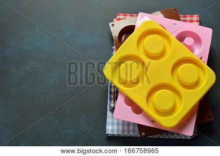 Silicone baking dish on a blue background culinary background