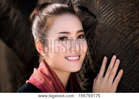beautiful girl with smiling elephant elephant village Surin Thailand Thai woman in traditional dress with elephant