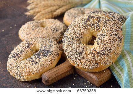 Bagels with sesame seeds on a brown background