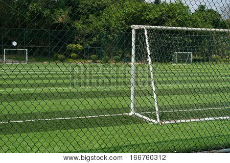 soccer field behind the fence horizontal composition