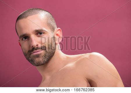 Young Man Smirking Pink Background Shirtless Handsome
