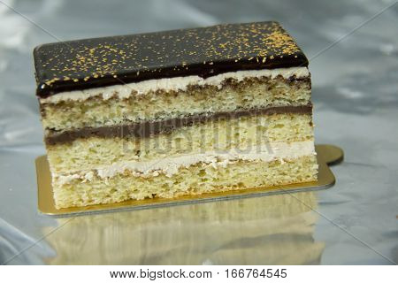 Delicious Opera cake with layers of chocolate ganache and coffee infused sponge cake.