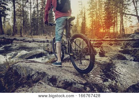 Ride On Mountain Bike At Sunset.