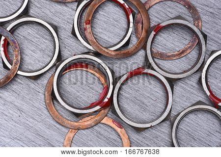 Nuts and Washers on Metal Background, Top View