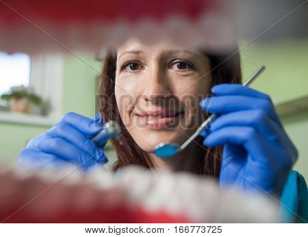 View From Mouth On The Smiling Female Doctor