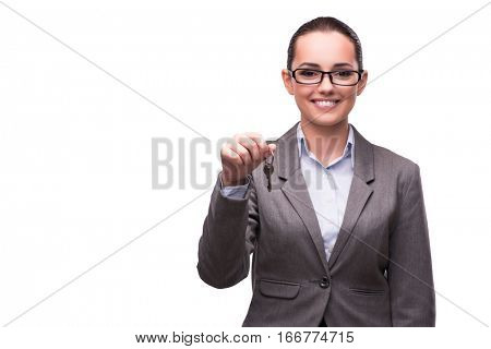 Woman holding keys in real estate concept