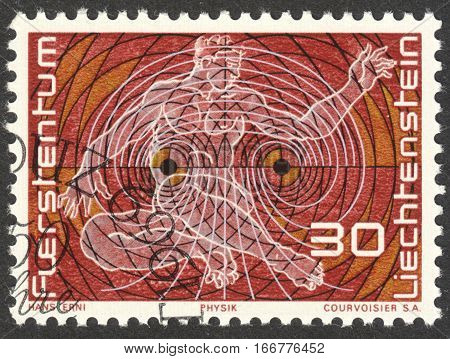 MOSCOW RUSSIA - CIRCA DECEMBER 2016: a post stamp printed in LIECHTENSTEIN Representation of Physics circa 1969