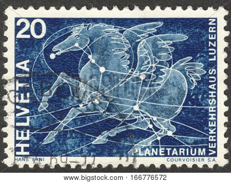 MOSCOW RUSSIA - CIRCA DECEMBER 2016: a post stamp printed in SWITZERLAND shows constellation of Pegasus dedicated to opening of the 1st Swiss planetarium Lucerne circa 1969