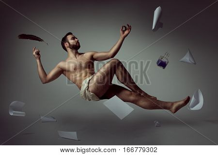 Half naked handsome man poet levitating with his literary things