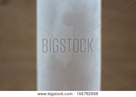 Top view Close up drops of ice cold bottle of water on wood background