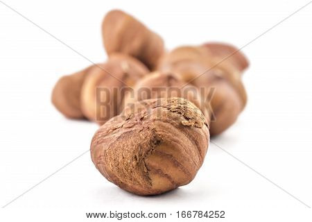 A pile of hazelnuts on a white background. Raw hazelnuts isolated on white background
