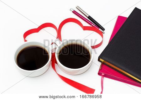 Cup Of Black Coffee, A Heart From Red Ribbon, Diaries And Pens On A White Background. Top View.