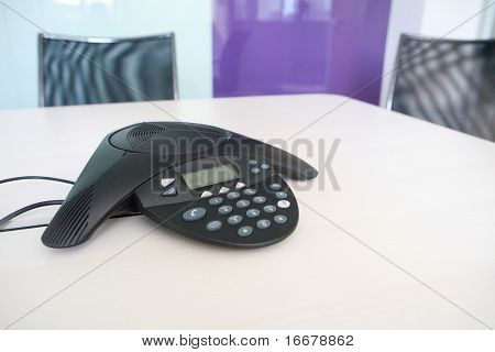 Inside a conference room - selective focus on keypad on phone