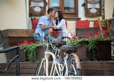 Retro Tandem Bicycle Near Red Flowers