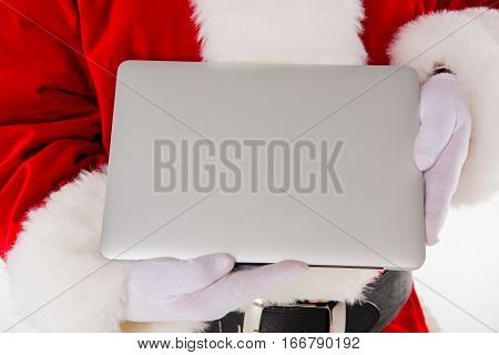 Cropped image of Santa Claus hand showing laptop computer