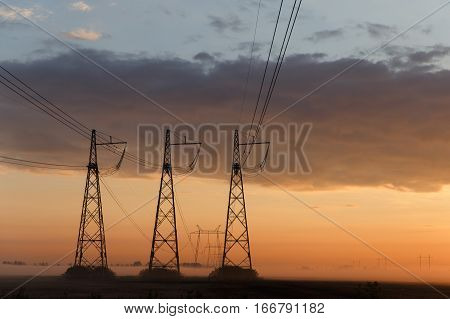 Reliance power lines against cloudy evening sky