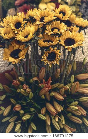 A beautiful bouquet of autumn sunflowers and lily blooms.
