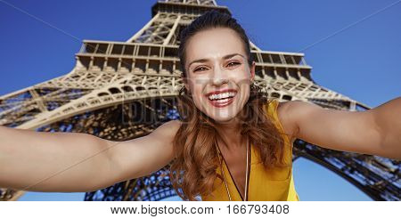 Happy Young Woman Taking Selfie While In Paris, France