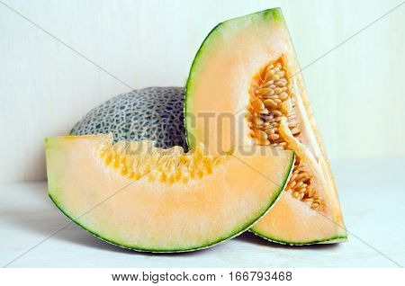 Cucumis Melo Or Melon With Half And Seeds On Wooden Plate