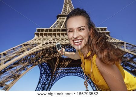 Happy Young Woman Taking Selfie With Phone In Paris, France