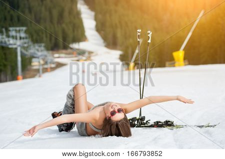 Beautiful Naked Female Skier Is Lying On Snowy Slope Near Ski Lift At  Resort