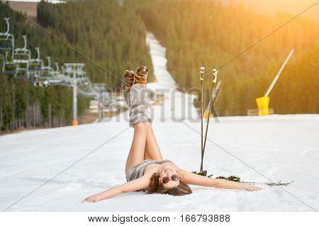 Young Happy Naked Skier Is Having Fun On Snowy Slope Near Ski Lift At Ski Resort