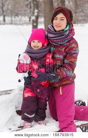 Family photo of mother and daughter in afternoon at winter