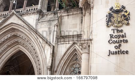 LONDON UK - MAY 9 2006: Better known simply as The Law Courts The Royal Courts of Justice houses the High Court and Court of Appeal of England and Wales. Many high profile case have been carried out here.