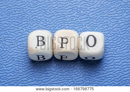 Word Bpo (business Process Outsoursing) On A Wooden Cubes On A Blue Background