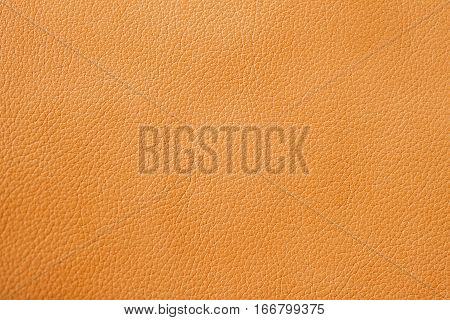 Texture of genuine leather close-up, cowhide, orange. For background , backdrop, substrate composition use