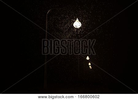 Snowfall in beam of lamp at night 3d render