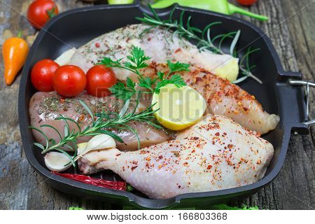 Raw chicken drumstick and raw chicken breast in pan - chicken raw meat