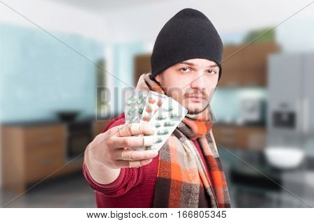 Man With Flu Holding Blisters With Pills