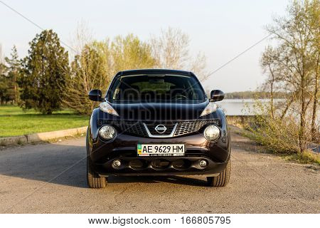 DNIPRO UKRAINE - APRIL 12 2016: NISSAN JUKE NEAR THE RIVER