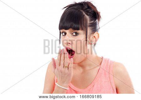 Yawning tired woman isolated on white background