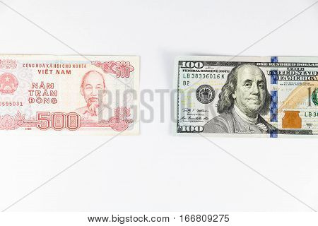 Close up view of US Dollar and Vietnam Dong indicating strong currency exchange rate