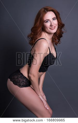 Beautiful Sexy Woman In Black Lace Lingerie Over Gray Background