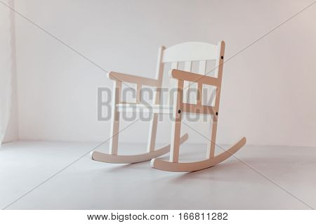 white rocking chair in a white empty room. Concept of solitude