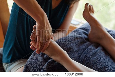 Reflexology massage foot treatment, reflexology massage therapist