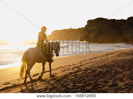 Seaside horse riding, beach horse riding, horse ride at sunset