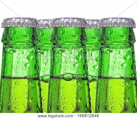 Closeup of five green beer bottles, the bottles are covered with condensation.- necks and caps only.