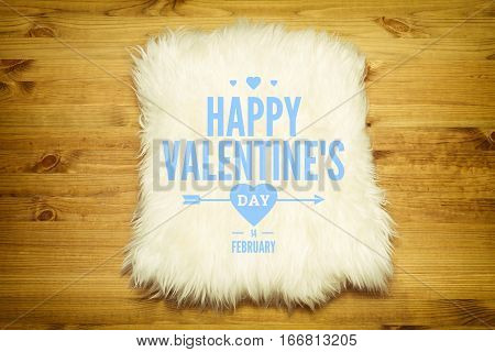Decorative fur carpet on wood floor background. Card for valentines day.