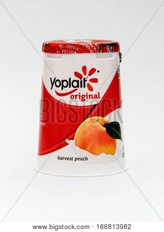 New York, January 5, 2017: A peach flavored Yoplait yogurt is seen against white background.