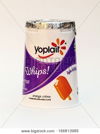 New York, January 5, 2017: An orange creme flavored Yoplait whipped yogurt is seen against white background.