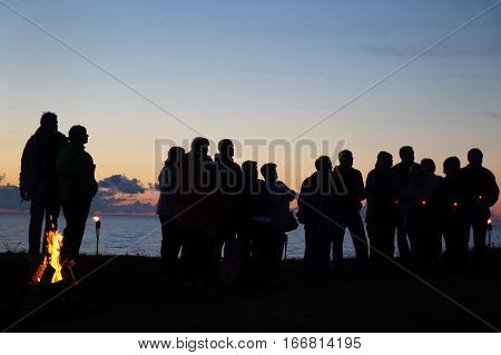 many peoples midsummer dark sunset sea fire
