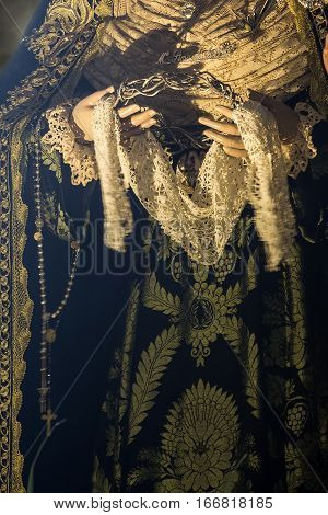 Holy week in Cadiz Spain. Holy Mary of the Peace. Hands details Closeup.