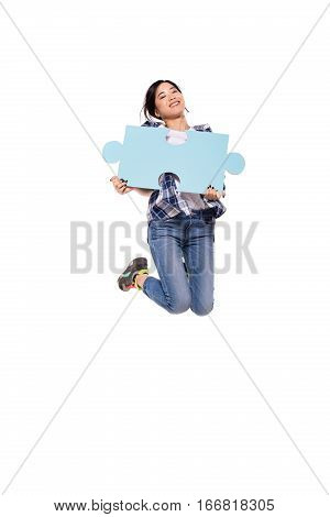 Asian  Women Jumping With Puzzle Pieces