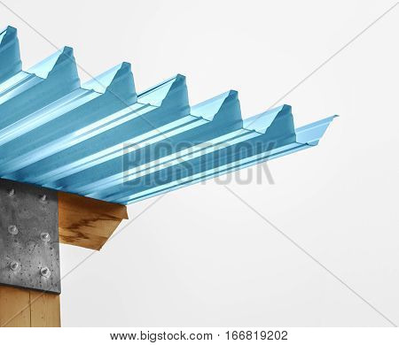 Corrugated blue roof top corner on a wooden plank
