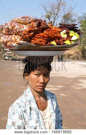 Pyin U Lwin Myanmar - 18 January 2010: Woman selling traditional Burmese street food in Pyin U Lwin