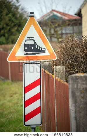 German triangle warning sign for incoming train